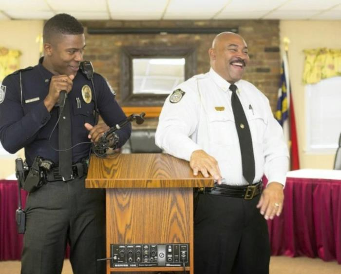 Officer Ronald Stewart sharing laugh with Cheif Hunt